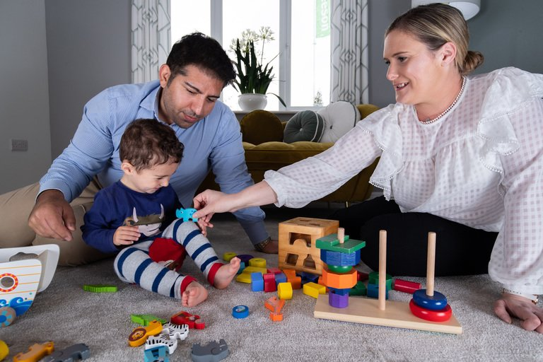 Kaivan- kat and luca - family playing on the floor in longford living room - holbeck park - 2020